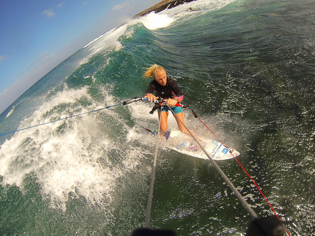 Kitesurfing by the reef with smaller waves